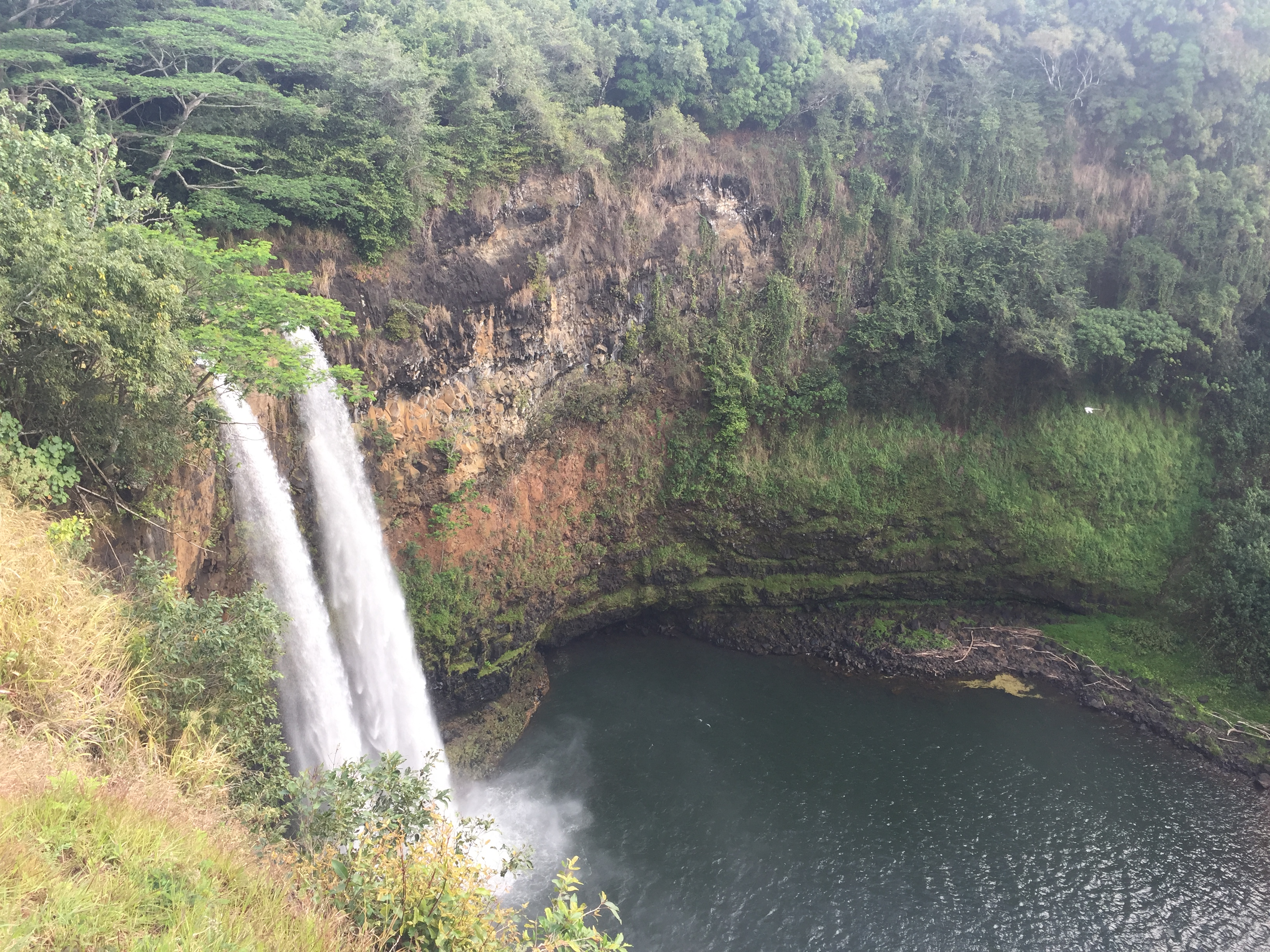 Wailua Falls, which feeds into the Wailua River